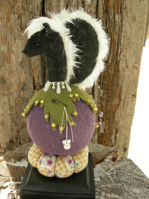 "SOLD:  No glue was used in the making of this sweet skunk pin cushion.  The piece is 9"" tall with a 4"" square base.  Please email for  availability"