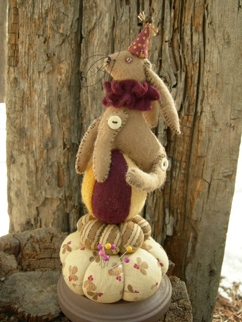 """SOLD: No Glue Used! Rabbit pin cushion  9 1/2"""" tall with a 4"""" base.  Made of wool felt and 1823 reproduction design fabric.  Please email for current availability."""
