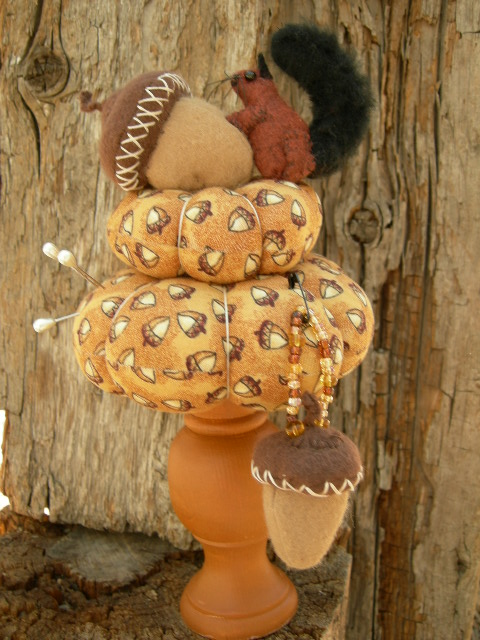 """SOLD:  NO glue used.  Squirrel on acorn is 10"""" tall base is 2 1/2"""" from side to side. Original Frayed Muslin."""