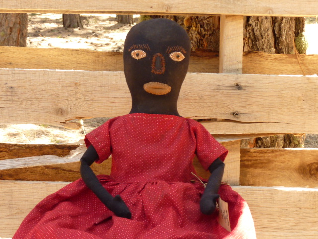 "SOLD:  She is 23"" tall.  Her body is made of vintage black fabric.  No paint was used.  Her cloths are nicely detailed.  She was adapted from the book American Folk Dolls.  Her face is wonderful.  Click on picture to enlarge for detail.  Eamail for more pictures or information."