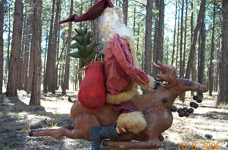 "SOLD OUT:::""PATTERN"" $15.00 Mailing $3.00 ~ PRE MADE $450.00 SHIPPING $9.00. ONE HALF OF $450.00 IS REQUIRED UPON ORDERING.  Santa on Reindeer stands approximately 22"" tall using a 8"" tall textile spool as a base.  Use what ever you want for a base as long as it gives support for this pair.  This is an Original Frayed Muslin Design with detailed instructions and two full color pictures.  Click on picture for larger view."